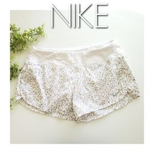 NIKE geometric pattern pockets running shorts